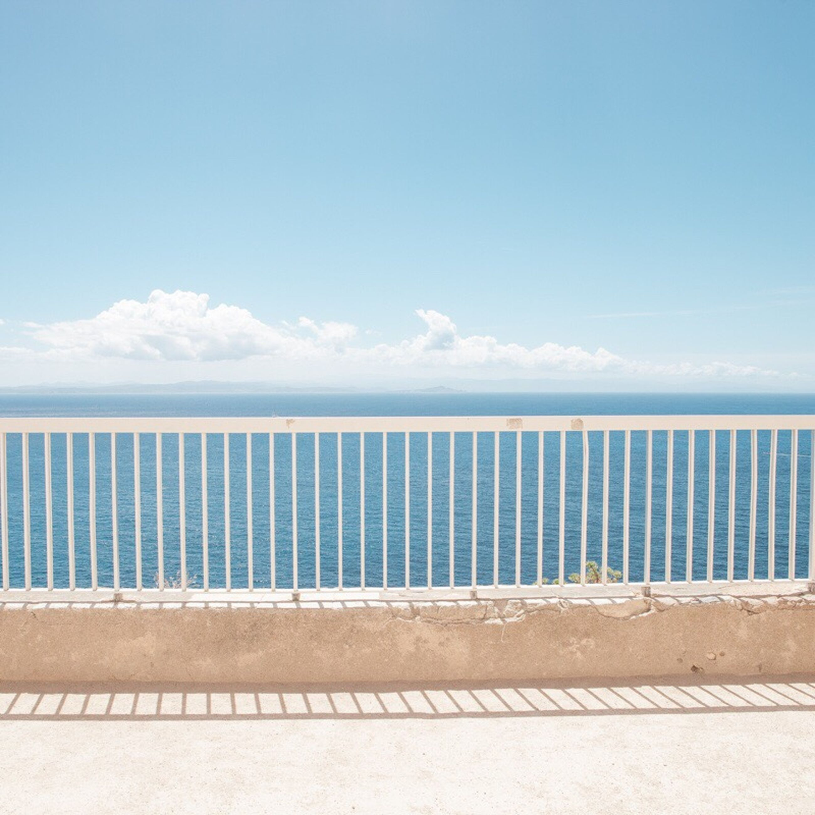 sea, beach, sand, blue, horizon over water, tranquility, water, tranquil scene, sky, nature, outdoors, day, beauty in nature, no people, scenics, wheelchair access
