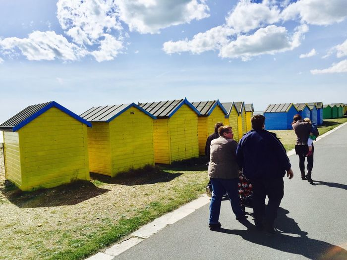 Spring walk by the beach huts Beach Huts People Women Full Length Lifestyles Outdoors Leisure Activity Togetherness Rear View Sunlight Walking Day Cloud - Sky Architecture Real People Built Structure Sky Walkjng Together
