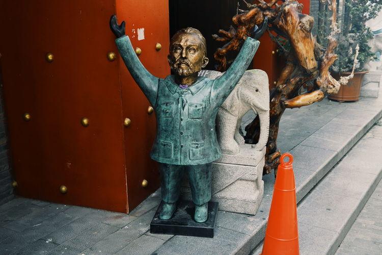 Full length of man holding sculpture