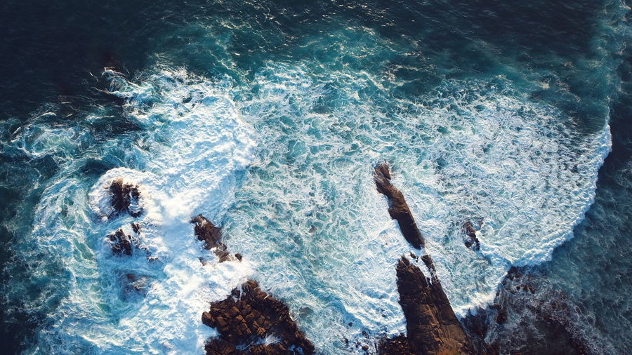 High angle view of sea by rock formation