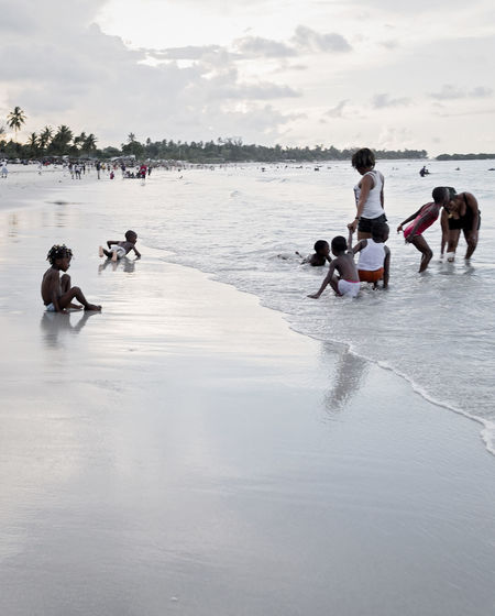 Children having fun at the beach. Beach Weekend Activities Children Having Fun Water Group Of People Land Day Real People Child Leisure Activity Boys Sky Nature Girls Men Women Childhood Lifestyles Females People Males  Outdoors My Best Photo Springtime Decadence