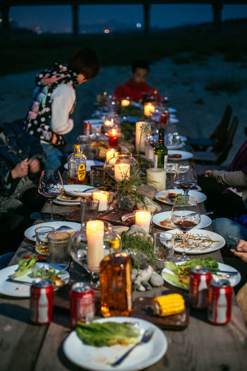 Burning Candle Dinner Fire Fire - Natural Phenomenon Flame Food Food And Drink Glowing Heat - Temperature Illuminated Lifestyles Meal Men Nature Outdoors People Plate Real People Selective Focus Table Women