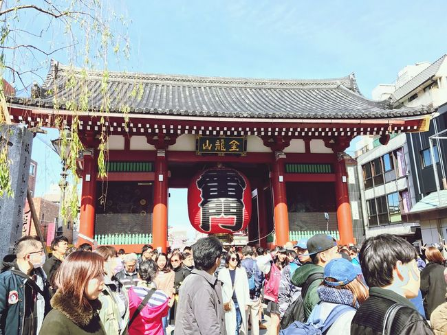 This is Kaminarimon Gate.On either side there are 2 large statues of buddhist deities. Japan Japanese Culture Japanese Shrine Japanese Traditional Outdoors Architecture Large Group Of People