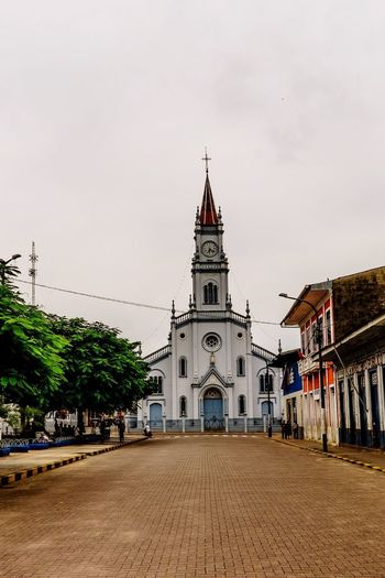 Catedral de Yurimaguas. Religion Architecture Place Of Worship Built Structure Spirituality Building Exterior Travel Destinations Sky Cloud - Sky History Clock Tower Day Outdoors Tree City No People Nature