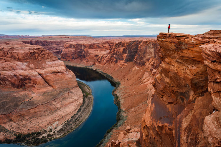 Photographer above the Colorado River at Horseshoe Bend, Arizona. Arizona Horseshoe Bend Woman Adventure American Southwest Beauty In Nature Cliff Colorado River Day Geology Nature One Person Outdoors Photographer Photography Physical Geography River Rock - Object Rock Formation Scenics Sky Tourism Tranquility Travel Destinations Water
