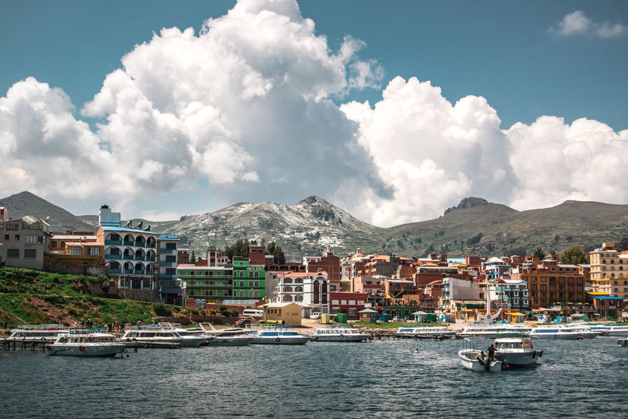 Exploring Isla del Sol and Copacabana, Bolivia. Copacabana Latin America Adventure Building Exterior Day Discover  Explore Mode Of Transportation Mountain Mountain Range Nature Nautical Vessel No People Outdoors Passenger Craft Residential District Sailboat Sea South America Transportation Travel Travel Destinations Water Waterfront Yacht The Traveler - 2018 EyeEm Awards