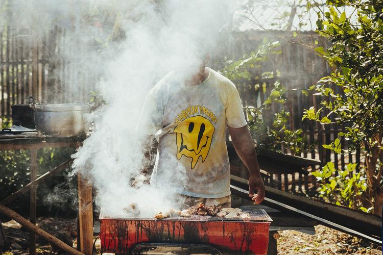 Rear view of man preparing food