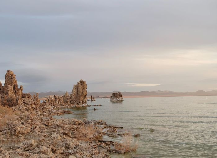 Landscape of tufa formations and Mono Lake Tufa Mono Lake Dawn EyeEm Selects Water Sky Sea Beauty In Nature Tranquility Scenics - Nature Nature Beach No People Land Outdoors Non-urban Scene Day Rock Rippled Cloud - Sky Horizon Over Water Tranquil Scene The Great Outdoors - 2018 EyeEm Awards