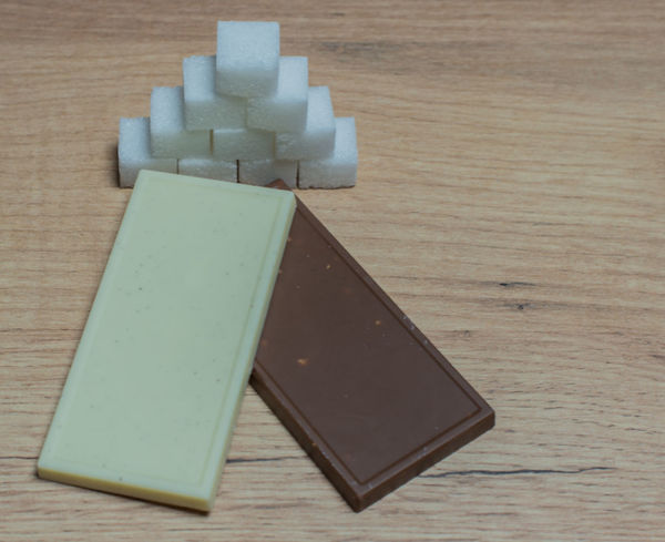 White and brown chocolate on a wooden board Chocolate Chocolate♡ Diabetic Harmful Isolated Snacking Sugar Brown Candy Cut Out Diabetes Food Health Nutrition Organic Sugar Cube Sweet Sweetener Sweets White