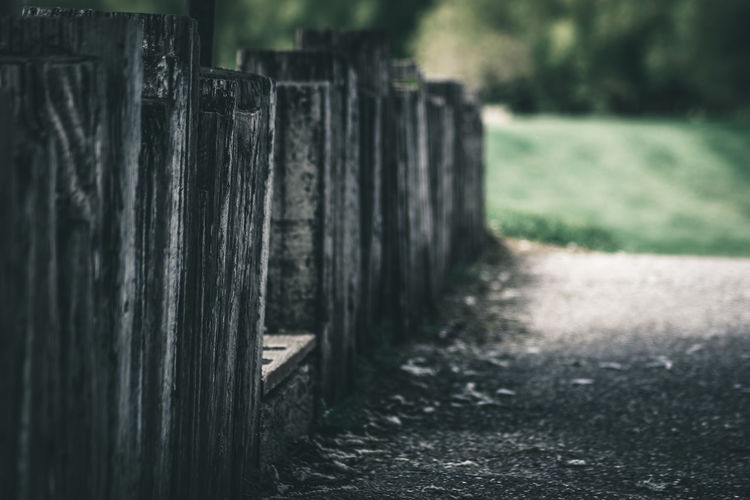 Close-up of wooden fence on field