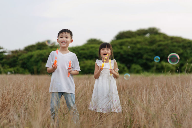 Kids Boys Cheerful Child Childhood Field Fields Grassland Innocence Land Outdoors Plant Togetherness Two People
