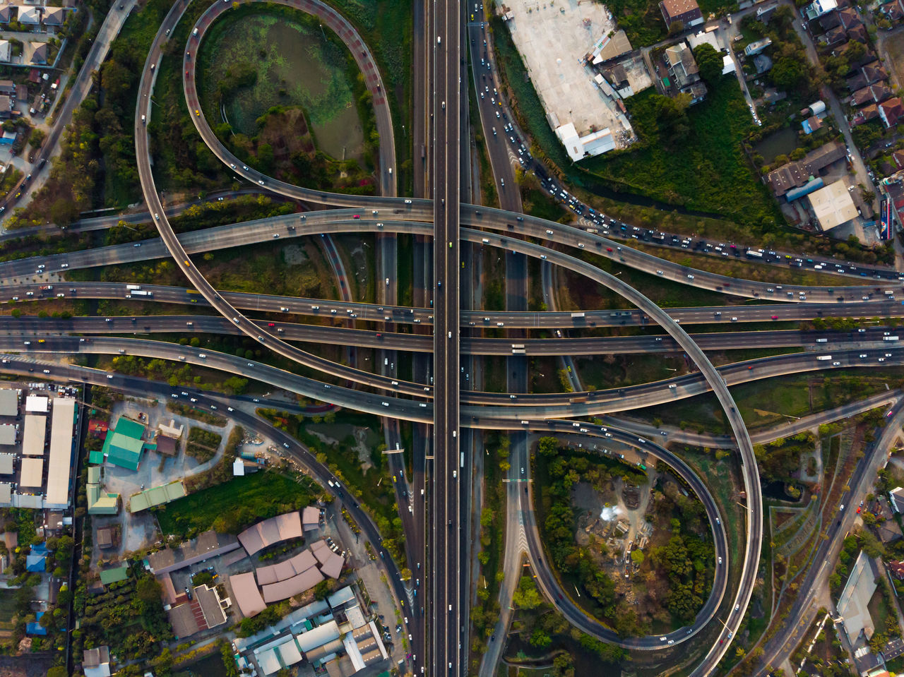 architecture, built structure, building exterior, city, no people, high angle view, road, transportation, connection, day, building, street, bridge, outdoors, aerial view, cityscape, city life, bridge - man made structure, mode of transportation, nature, multiple lane highway, complexity, overpass
