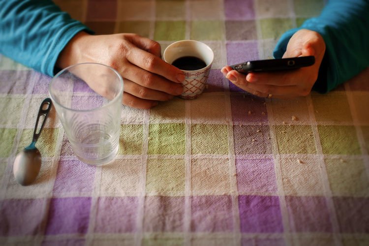 Breakfast Stillife Break Coffee - Drink Coffee Cup Holding Human Body Part Human Hand Message Mobile Phone Real People Smart Phone Sms Texting Table
