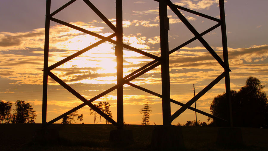 1717 Tree Sunset Silhouette Steel Industry Complexity Urban Skyline Dramatic Sky Electricity Pylon Moody Sky Romantic Sky This Is Strength
