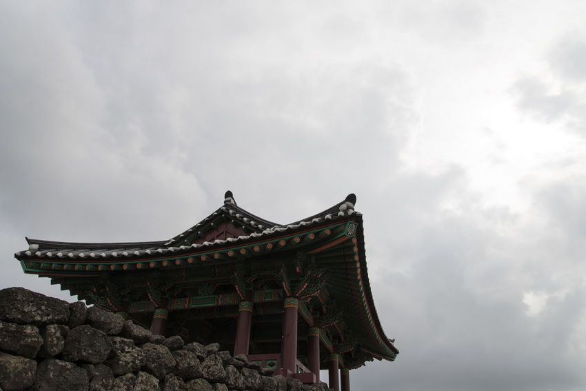 landscape of Seongeup Folk Village in Jeju Island, South Korea JEJU ISLAND  Seongeup Folk Village Architecture Building Exterior Built Structure Cloud - Sky Day Dragon Eaves Low Angle View Nature No People Outdoors Place Of Worship Roof Sky