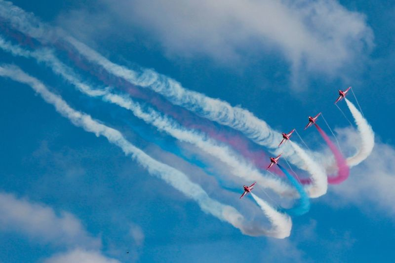 Vapor Trail Sky Cloud - Sky Airshow Smoke - Physical Structure Teamwork Speed Low Angle View Airplane Transportation Flying Air Vehicle Mode Of Transport Blue Military Airplane Outdoors Performance Day Motion Fighter Plane Red Arrows