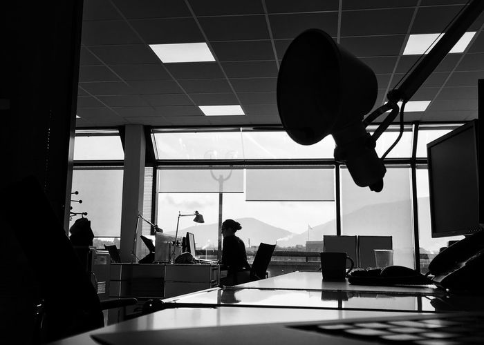 Silhouette Lamp Over Table In Office