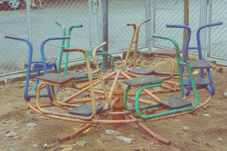 Abandoned chairs in playground