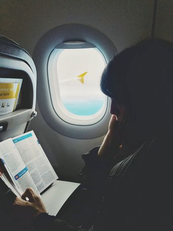 Vehicle Interior Transportation Airplane Mode Of Transport Vehicle Seat Window Real People Air Vehicle One Person Sitting Journey Travel Indoors  Flying Day Car Interior Airplane Seat Lifestyles Women Commercial Airplane Photographer IPhone Photography Sky Vscocam