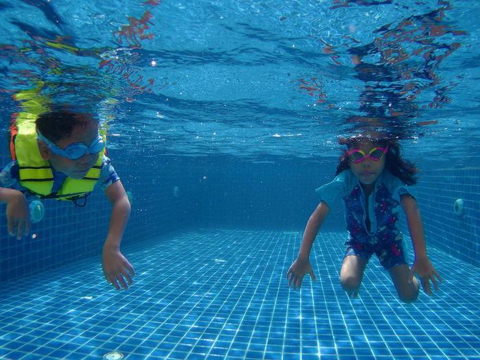 Full length of a girl swimming in pool