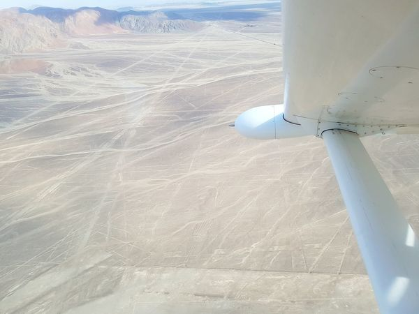 Nasca Nasca Lines High Angle View Airplaneview Airplane View Archeology Peru Historical Site Sand Sea Sky Sand Dune Aircraft Wing Arid Landscape Arid Airplane Wing Airplane Desert Aerial View Arid Climate Aeroplane