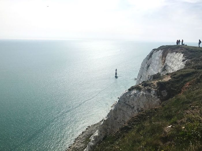 Sea Water Nature Beauty In Nature Scenics Horizon Over Water Tranquility Tranquil Scene Sky Day Rock - Object Real People Cliff Outdoors Men Standing One Person People Ocean White Cliffs