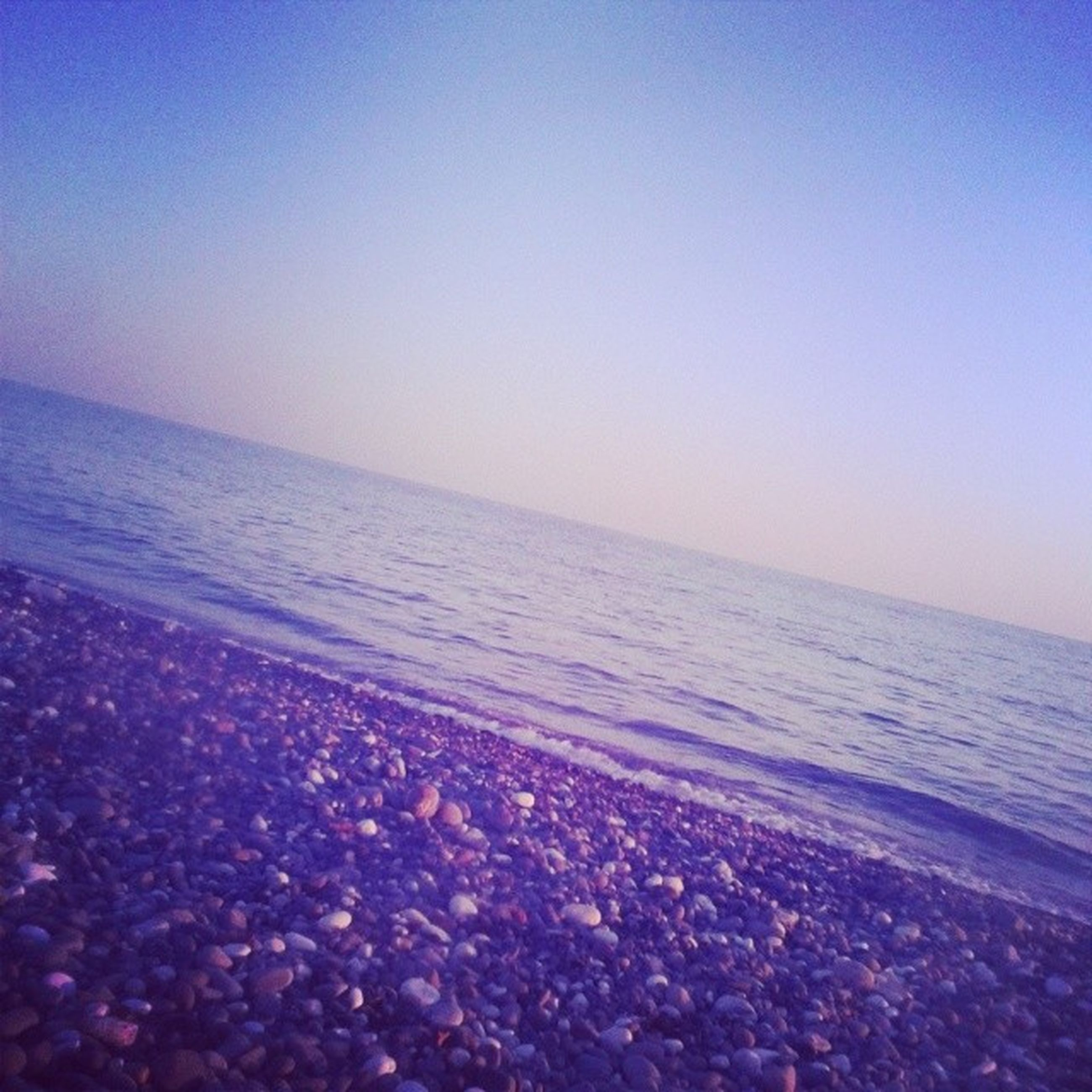 sea, horizon over water, beach, water, shore, scenics, clear sky, tranquil scene, tranquility, beauty in nature, copy space, nature, blue, sand, idyllic, sky, coastline, calm, sunset, outdoors