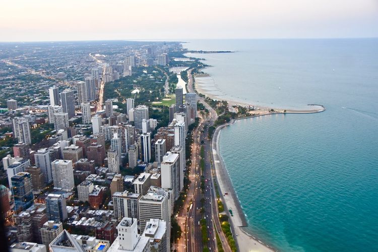 EyeEm Best Shots Lake Michigan Aerial View Architecture Beauty In Nature Building Exterior City City Scape Cityscape Day Diminishing Perspective High Angle View Horizon Over Water Idyllic Landscape Nature No People Outdoors Scenics Sky Skyscraper Sunset Tourquise Travel Destinations Water The Week On EyeEm