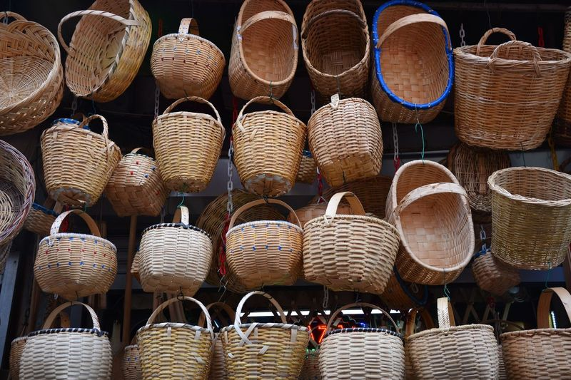 Low angle view of wicker baskets for sale at market