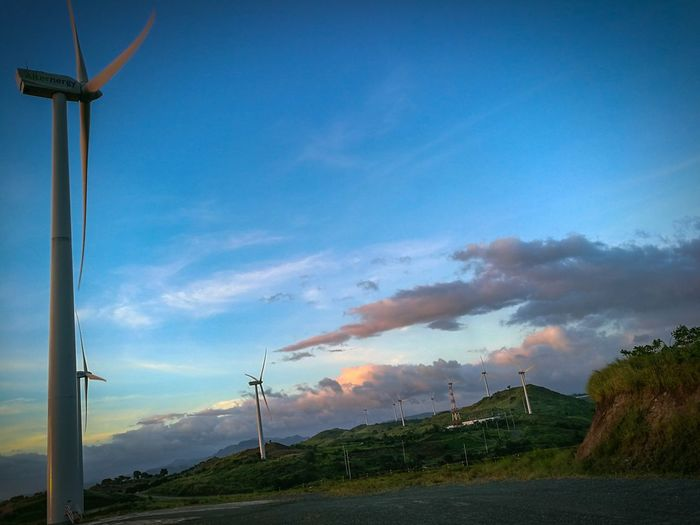 Blue Sky Electricity  Fuel And Power Generation Power Supply Cable No People Nature Alternative Energy Cloud - Sky Wind Turbine Outdoors Landscape Electricity Pylon Tree Beauty In Nature Day