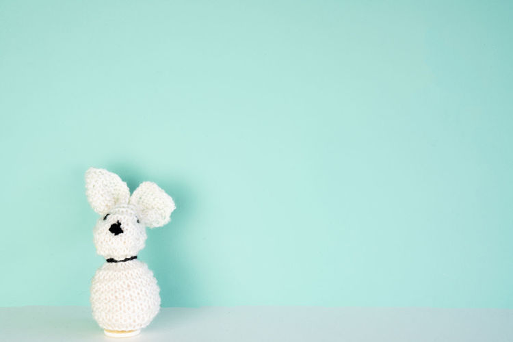 stuffed bunny toy in front of an colored background, with space next to it Studio Shot Copy Space Colored Background Indoors  Blue Stuffed Toy Toy Cut Out Single Object Blue Background Simplicity White Color Softness Holiday Easter Wallpaper Bunny  White Backgrounds Cute Close-up Concept