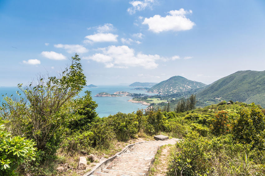 Big waves beach is part of Shek O country park in Hong Kong island. This is the end of the very popular Dragon's Back Trail. Beauty In Nature China Cloud - Sky Day Grass Growth Hong Kong Landscape Mountain Mountain Range Nature No People Outdoors Plant Scenics Shek O Sky The Way Forward Tranquil Scene Tranquility Travel Tree Waves