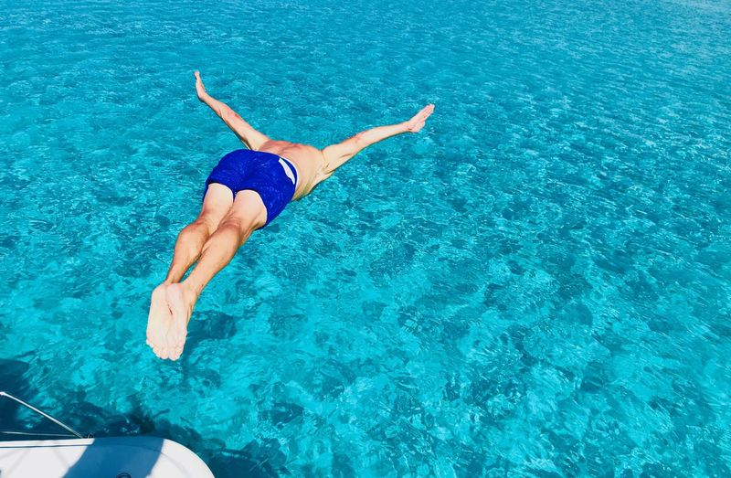 Jumping from the boat Water One Person Swimwear Lifestyles Pool Full Length Clothing