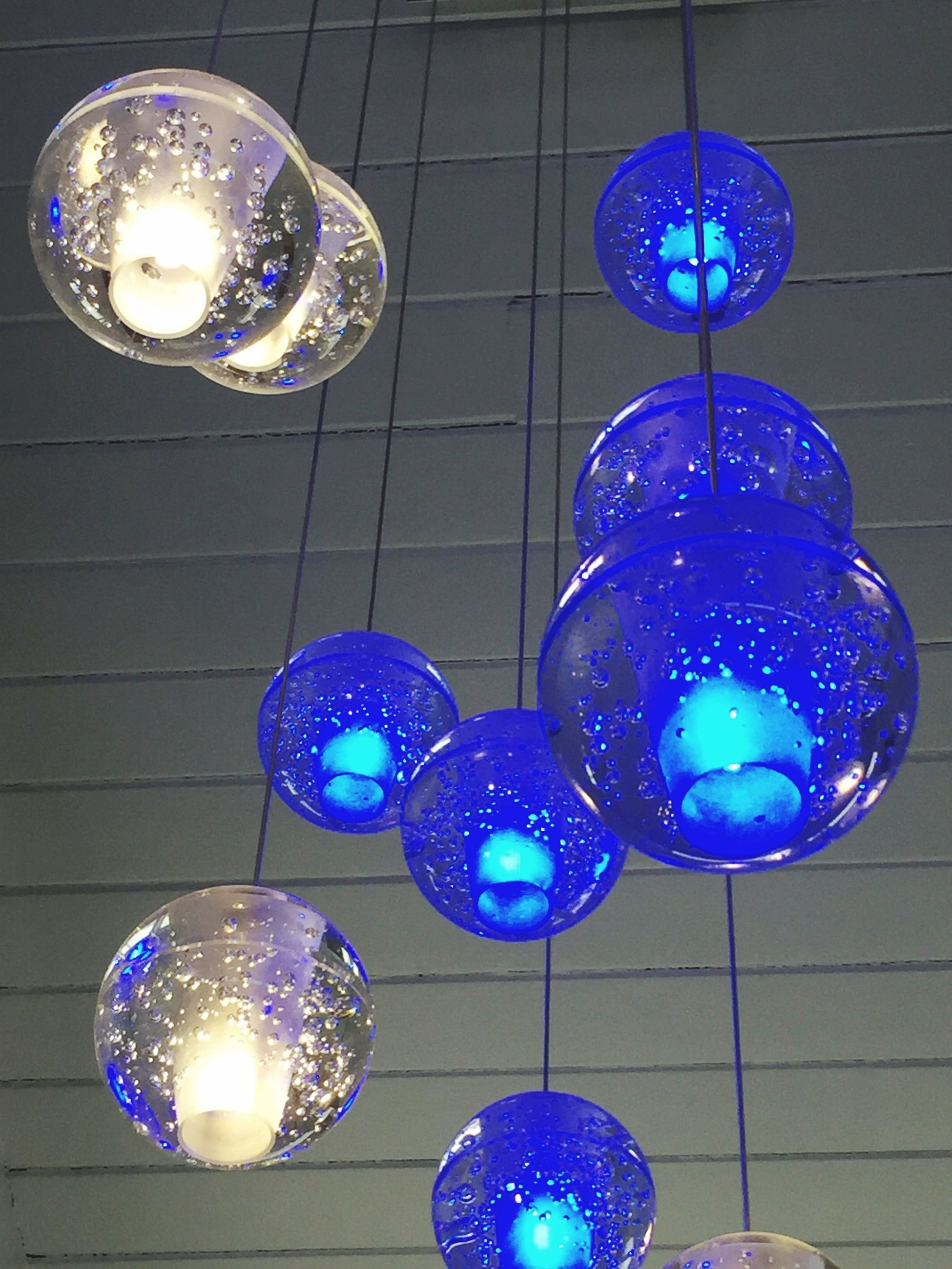 disco ball, blue, lighting equipment, hanging, illuminated, low angle view, party - social event, shiny, no people, event, multi colored, indoors, disco dancing, dance floor, night, luminosity, helium