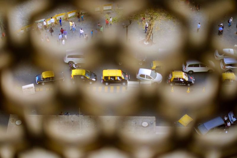 City Street Seen Through Fence