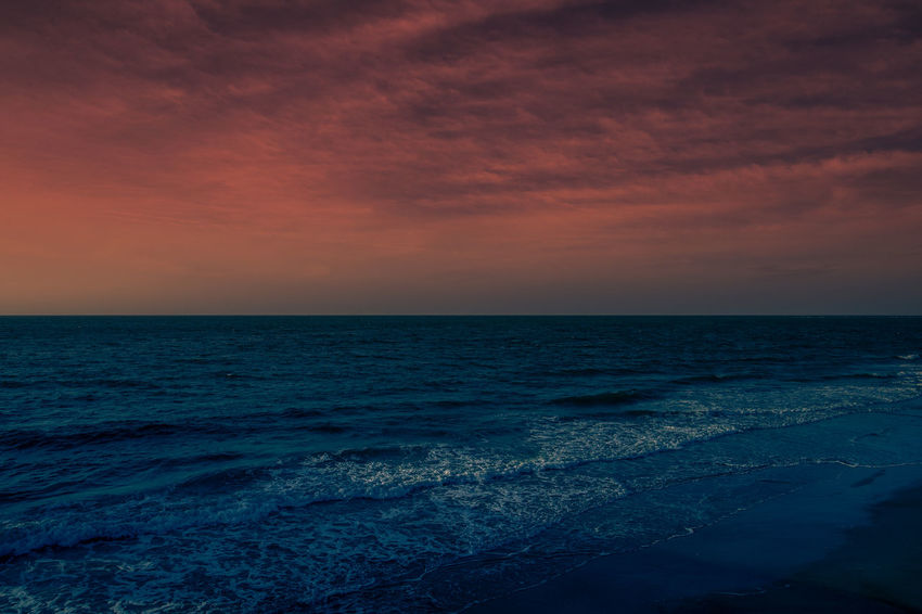 Sunset over the Atlantic Ocean on Tybee Island beach. Beach Beauty In Nature Horizon Horizon Over Water Idyllic Nature No People Outdoors Scenics Sea Sky Sunset Tranquil Scene Tranquility Water Wave