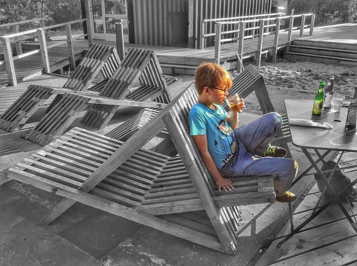 Enjoying Life Boy Coffeshop Hanging Out Chairs Denmark Roskilde IPhoneography Fine Art Photography Tranquility Almost Black&white Blackandwhite Furniture Design