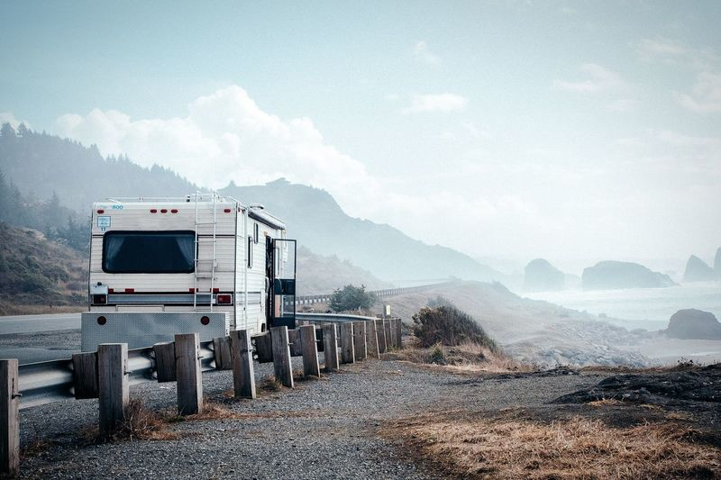 Oregon is full of vans, and it's easy to see why people want to be on the road here all the time Van Van Life Camp Life Coast Nature Sky Landscape Day Mountain Range No People Outdoors Beauty In Nature Motor Home Oregon Trailer Observing Nature Rv Rocks Pistol River State Park Mist Foggy Landscape In The Mist Tranquility Wanderlust Travel An Eye For Travel