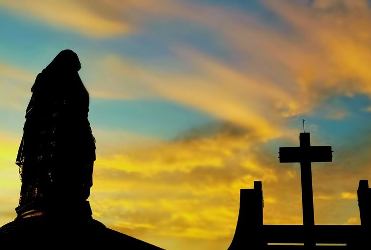 Silhouette of the large Saint Ann statue with cross pole on roof church with blurred sunrise sky background on architecture design and art of religion concept Faith Worship Christianity Church Top Of Roof Statue Saint Ann Backside Shape Shadow Blur Background Yellow Colorful Sunrise Morning Art Religion Sunset Cross Storm Cloud Spirituality Religion Dramatic Sky Sky Cloud - Sky Cross Shape Crucifix Jesus Christ