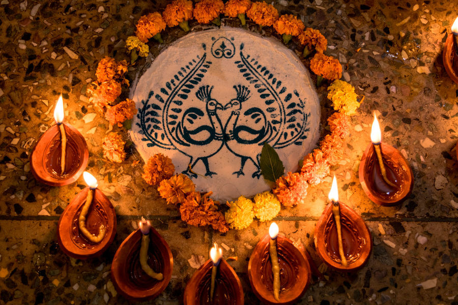 Rangoli Burning Candle Close-up Day Diwali Diya - Oil Lamp Fire - Natural Phenomenon Flame Flower Glowing Heat - Temperature High Angle View Illuminated Indoors  No People Oil Lamp Peacock Place Of Worship Religion Spirituality
