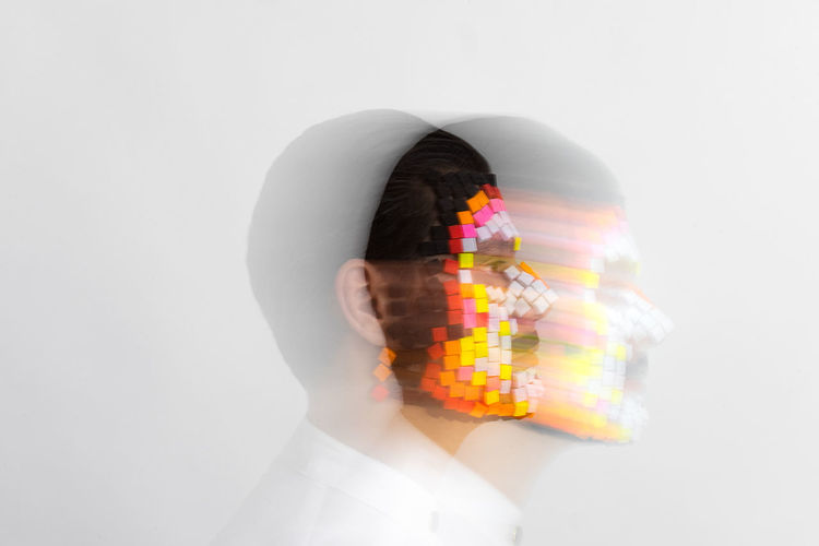 Digital composite image of man with colored mask