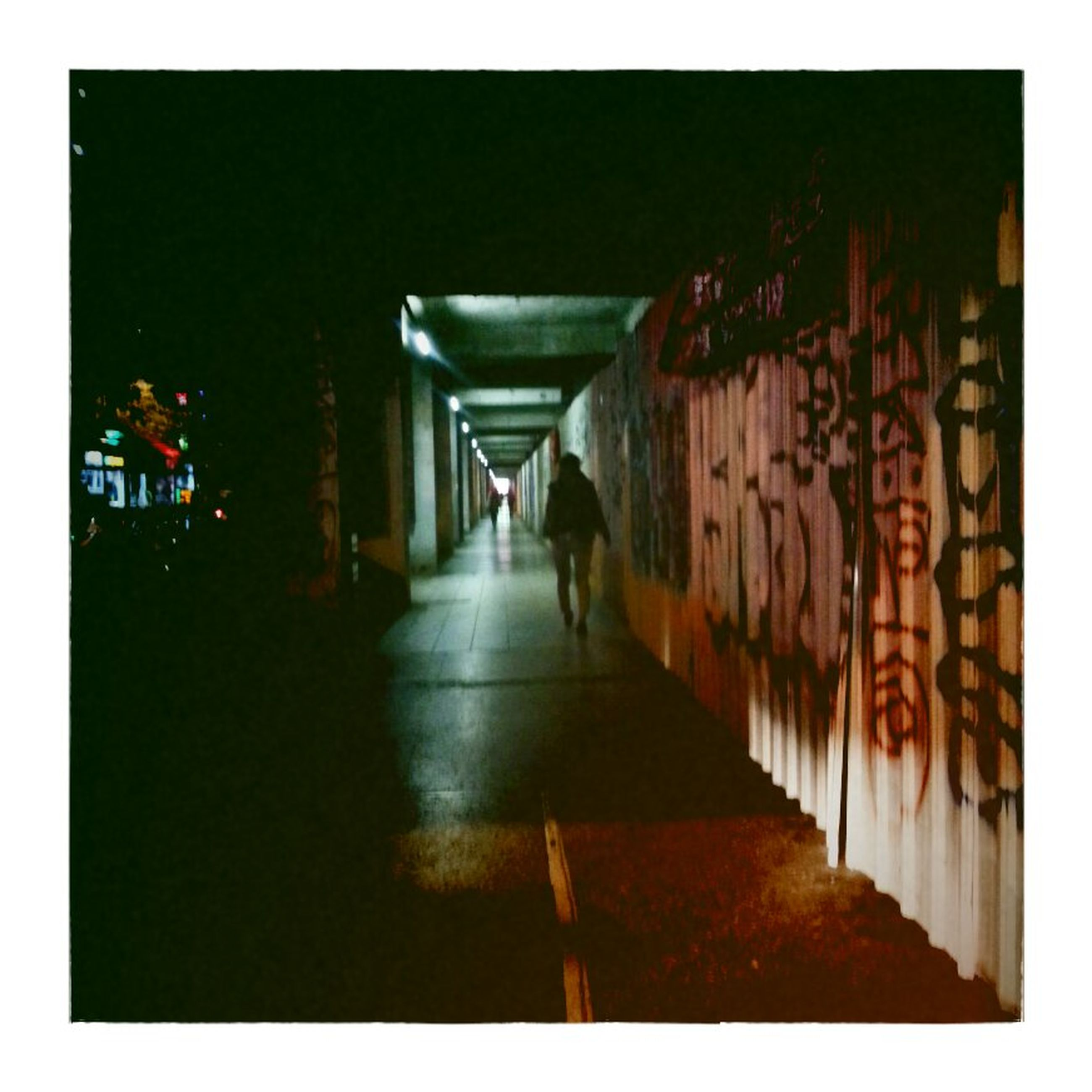 transfer print, the way forward, auto post production filter, architecture, diminishing perspective, built structure, vanishing point, building exterior, transportation, walking, street, illuminated, men, narrow, night, road, long, city, wall - building feature