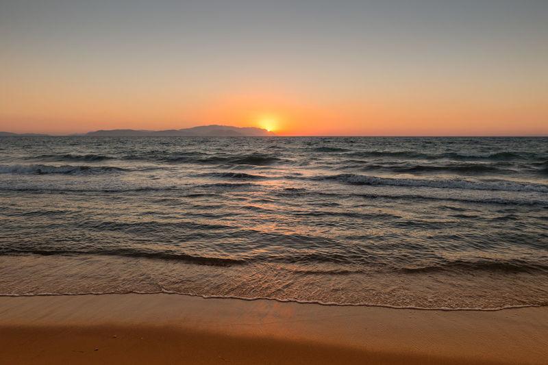 Idyllic shot of sea against sky during sunset