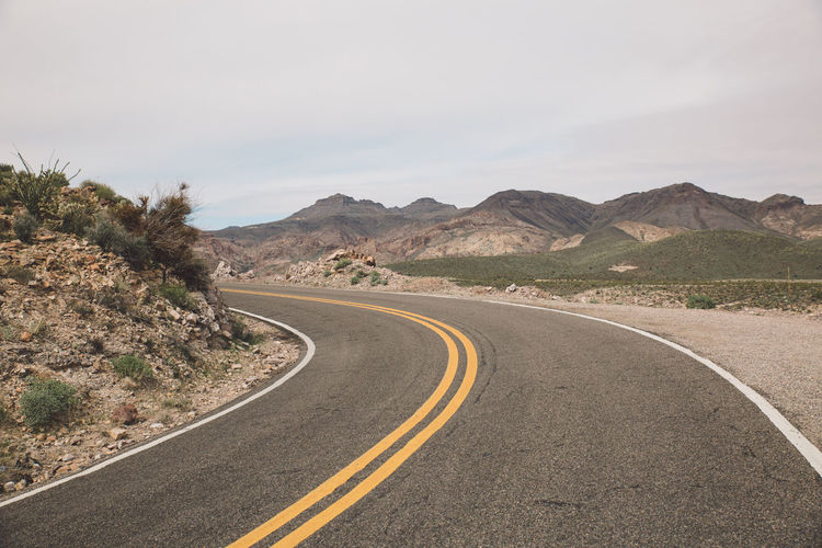 Arid Climate Arid Landscape Arizona Desert Empty Historic Route 66 Landscape Mountain Mountain Range Mountains Nature Oatman Physical Geography Remote Road Road Road Marking Roadtrip Rock - Object Route 66 Scenics The Way Forward Tranquil Scene Transportation Winding Road Stay Out