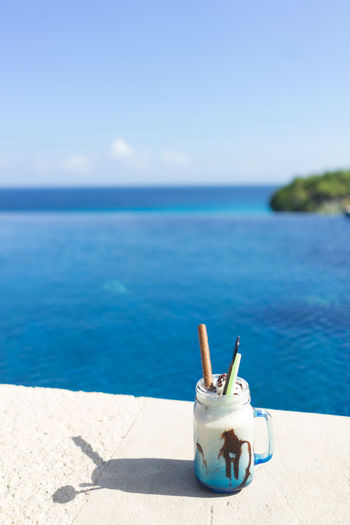 Ice Vacations Beach Beauty In Nature Blue Day Drink Drinking Straw Focus On Foreground Food Food And Drink Freshness Glass Horizon Horizon Over Water Icecream Land Nature No People Outdoors Pool Refreshment Sea Sky Straw Sunlight Water