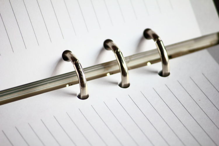 Close-up of note book with ring binder