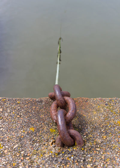 Dorset Chain Close-up Day Focus On Foreground Food And Drink Hanging High Angle View Iron Lake Metal Nature No People Old Outdoors Pebble Rusty Solid Still Life Strength Water Weathered