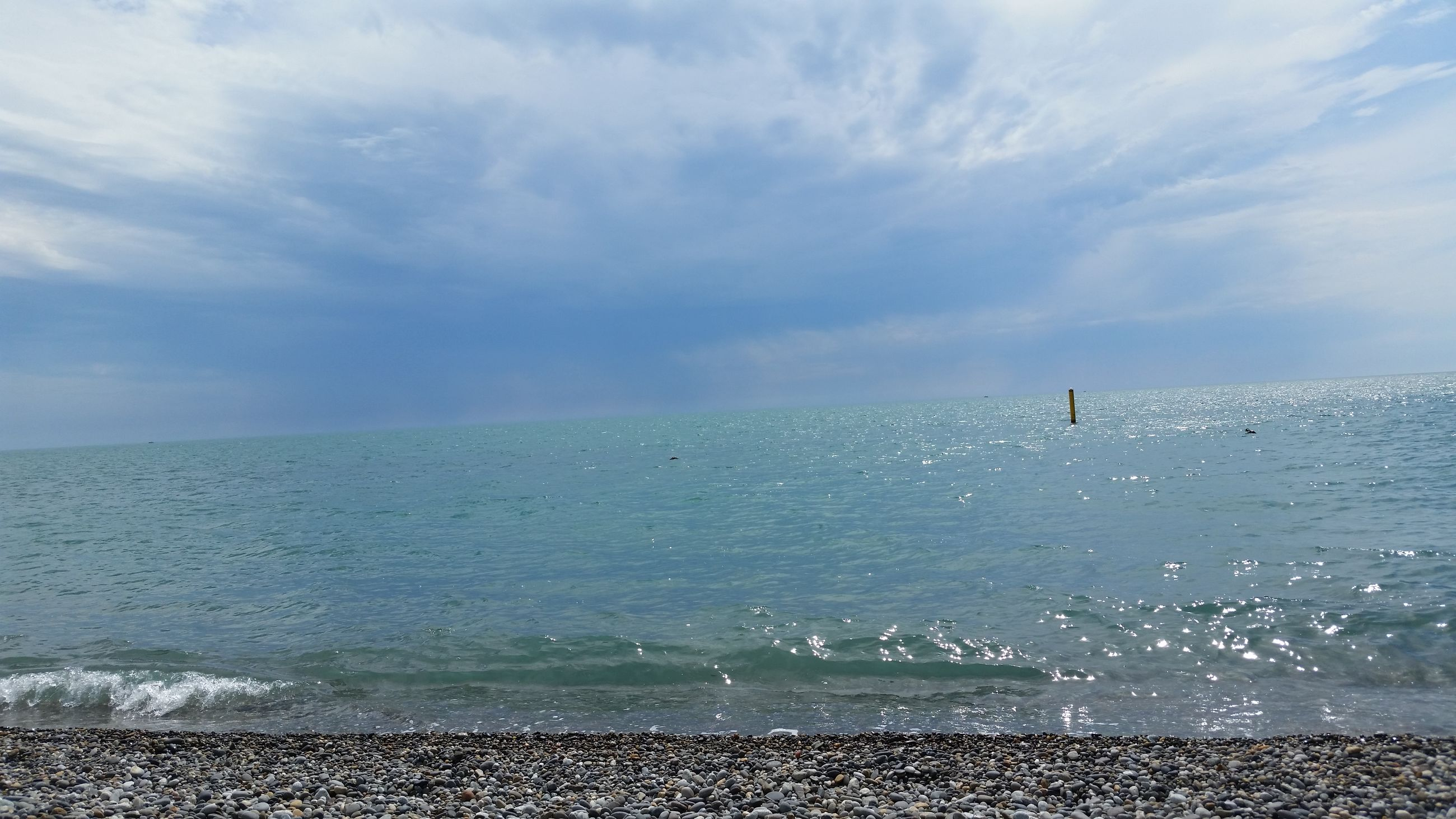 sea, water, beach, horizon over water, sky, scenics, shore, tranquil scene, beauty in nature, tranquility, sand, cloud - sky, nature, idyllic, cloud, cloudy, wave, coastline, seascape, outdoors