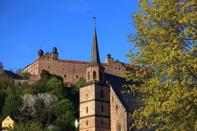 old city and castle Plassenburg and church Petrikirche of Kulmbach, Frankonia, Bavaria, Germany Plassenburg Architecture Autumn Belief Blue Building Building Exterior Built Structure Change Clear Sky Day History Kulmbach Low Angle View Nature No People Outdoors Place Of Worship Plant Religion Sky Spire  The Past Tree