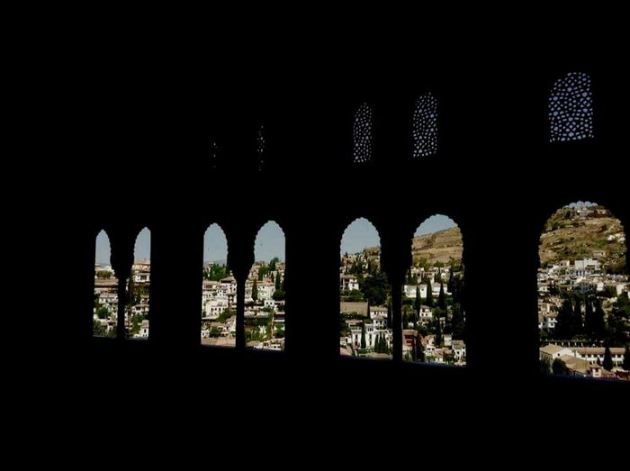 Alhambra, Granada(Spain) Sculpture City Travel Destinations Built Structure Architecture Church Men Standing Low Angle View Crowd Togetherness Casual Clothing Carefree Architecture Arch Built Structure Window Indoors  Dark Architectural Column Sky Arched Arcade No People Interior